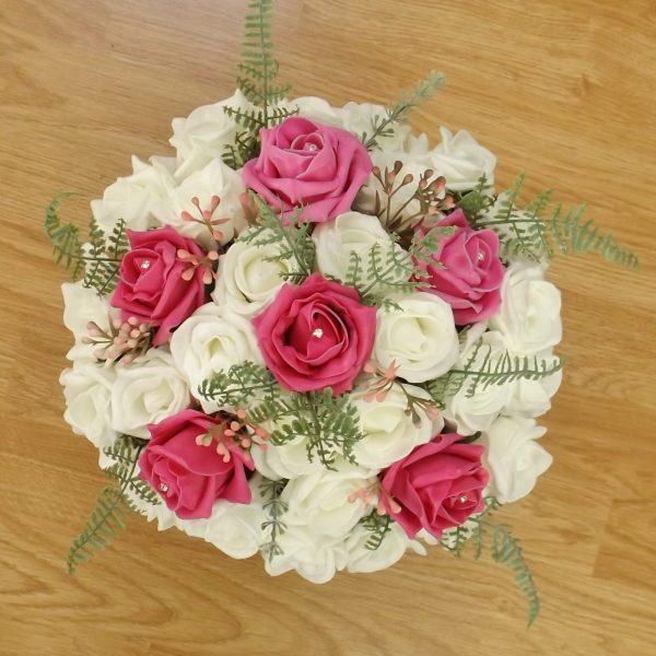 bright pink fern rose brides bouquet