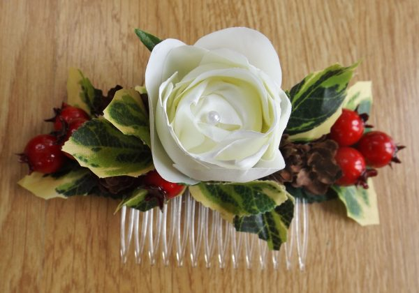 A christmas pinecone and berry hair comb