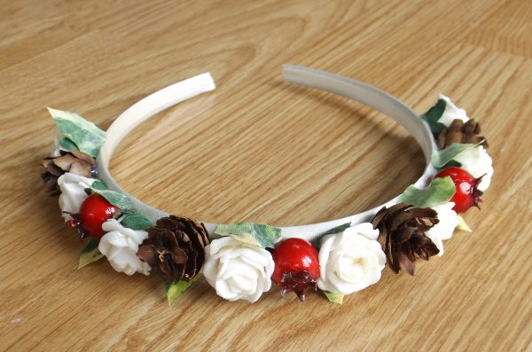 A berry and pinecone hairband