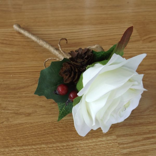 A berry, pinecone and holly flowergirl wand