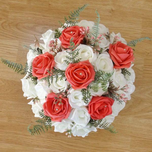 coral fern rose brides bouquet