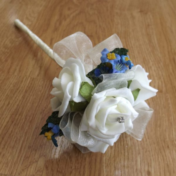 An ivory foam rose forget me not wand