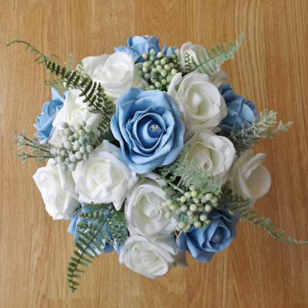 light blue rose fern foliage bridesmaid bouquet