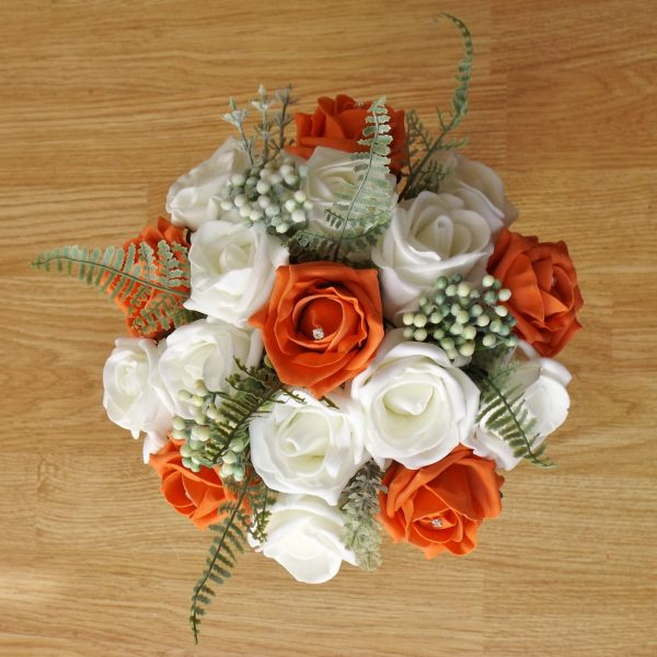 orange rose fern foliage bridesmaid bouquet