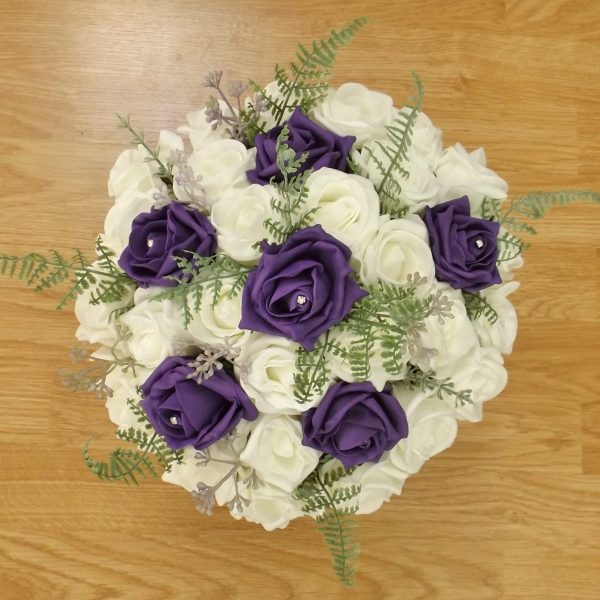 purple fern rose brides bouquet