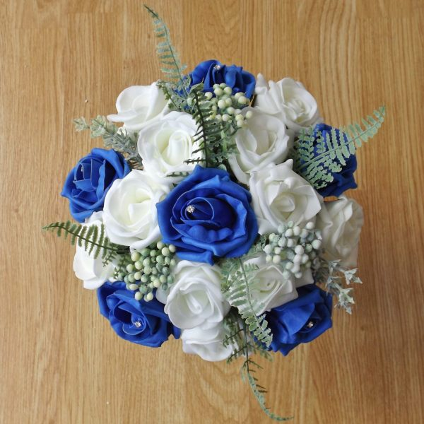 royal blue rose fern foliage bridesmaid bouquet