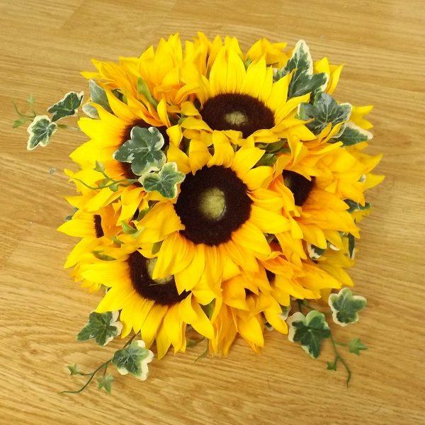 A silk sunflower and ivy centrepiece