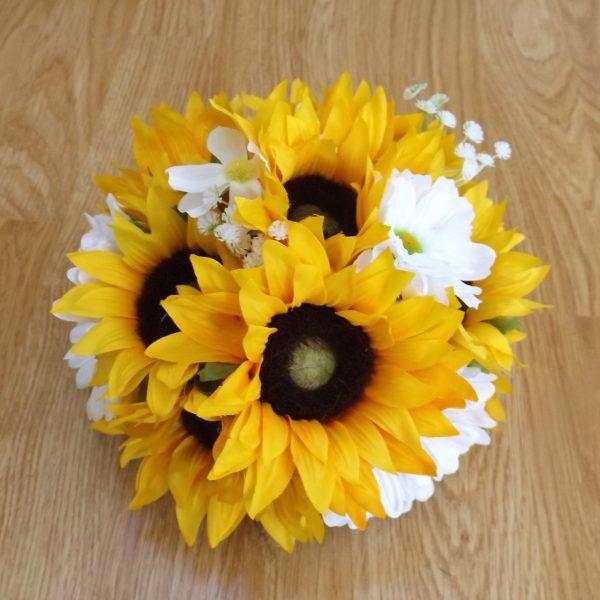 A silk sunflower and daisy centrepiece