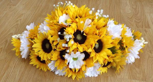 Silk sunflower and daisy top table arrangement with gypsophila