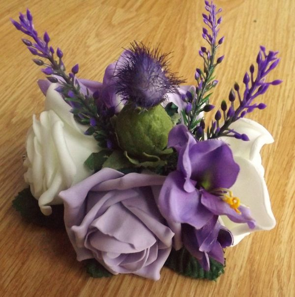 A thistle and heather artificial rose cake topper