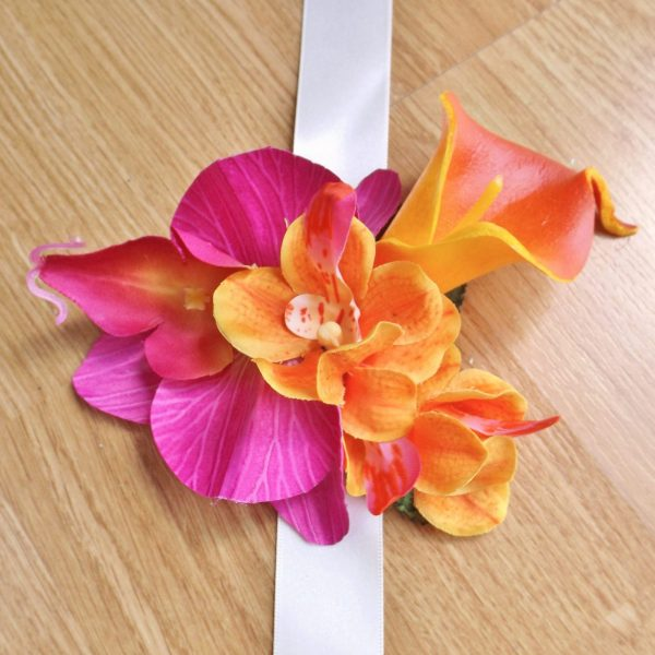 Bright pink & orange tropical wrist corsage