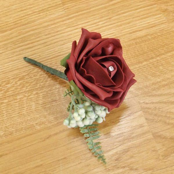 burgundy fern buttonhole