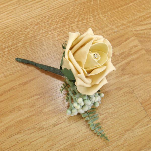 gold fern buttonhole