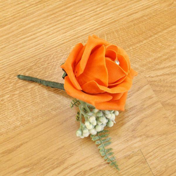 orange fern buttonhole