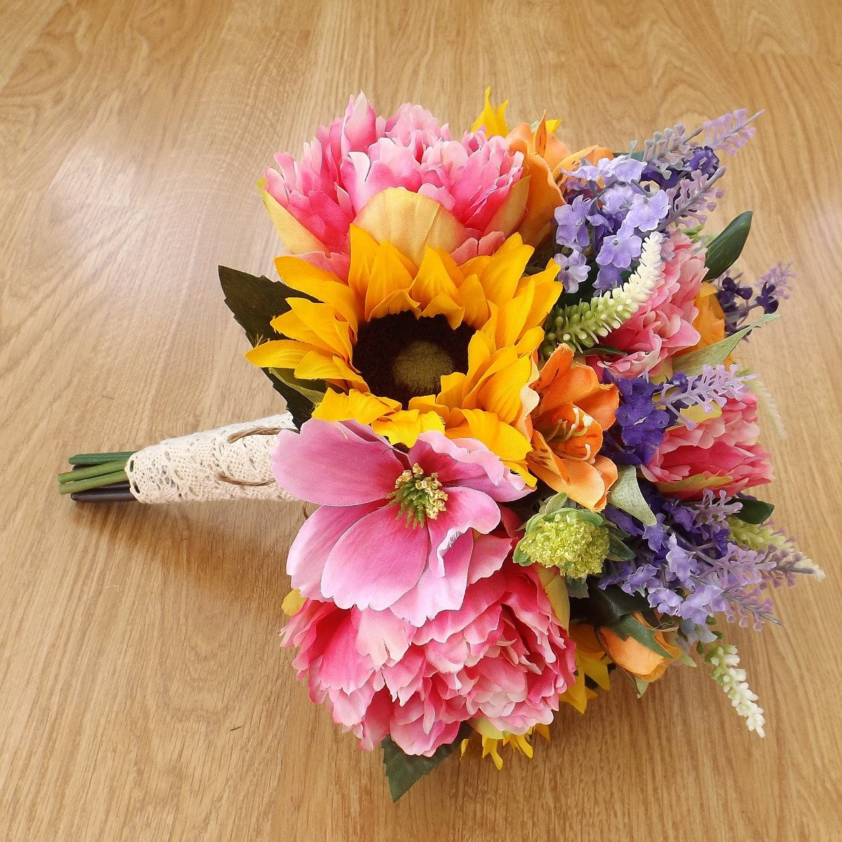 An artificial sunflower & wildflower brides bouquet