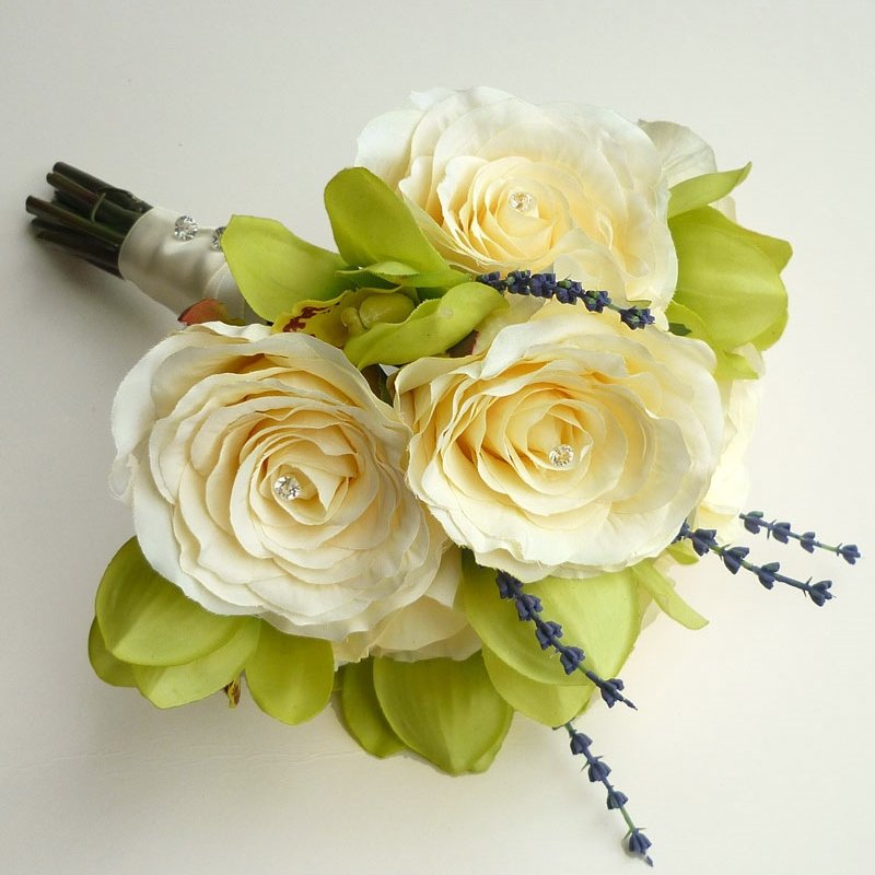 An ivory rose, orchid and lavender brides bouquet