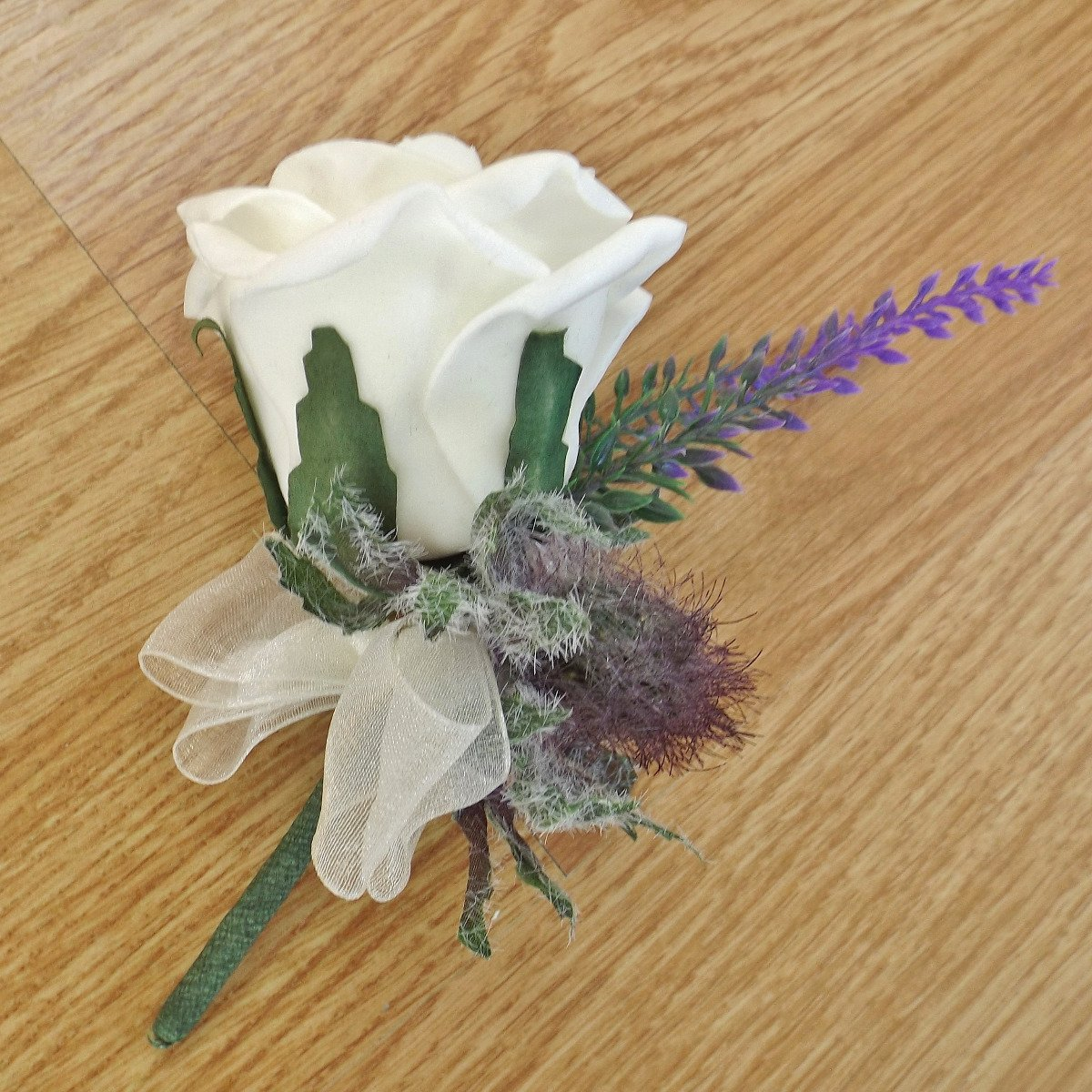 An artificial thistle and heather buttonhole