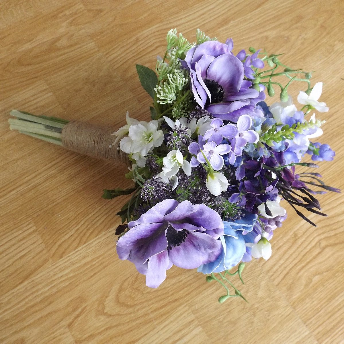 An artificial lilac & blue wildflower brides bouquet