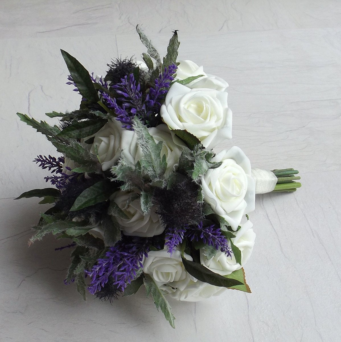 A thistle and heather brides bouquet