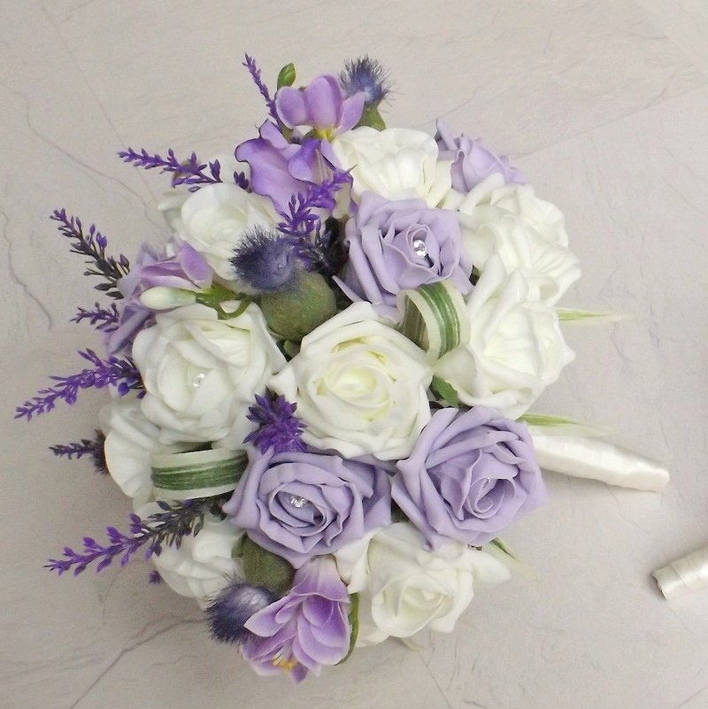 An artifical thistle and heather brides bouquet