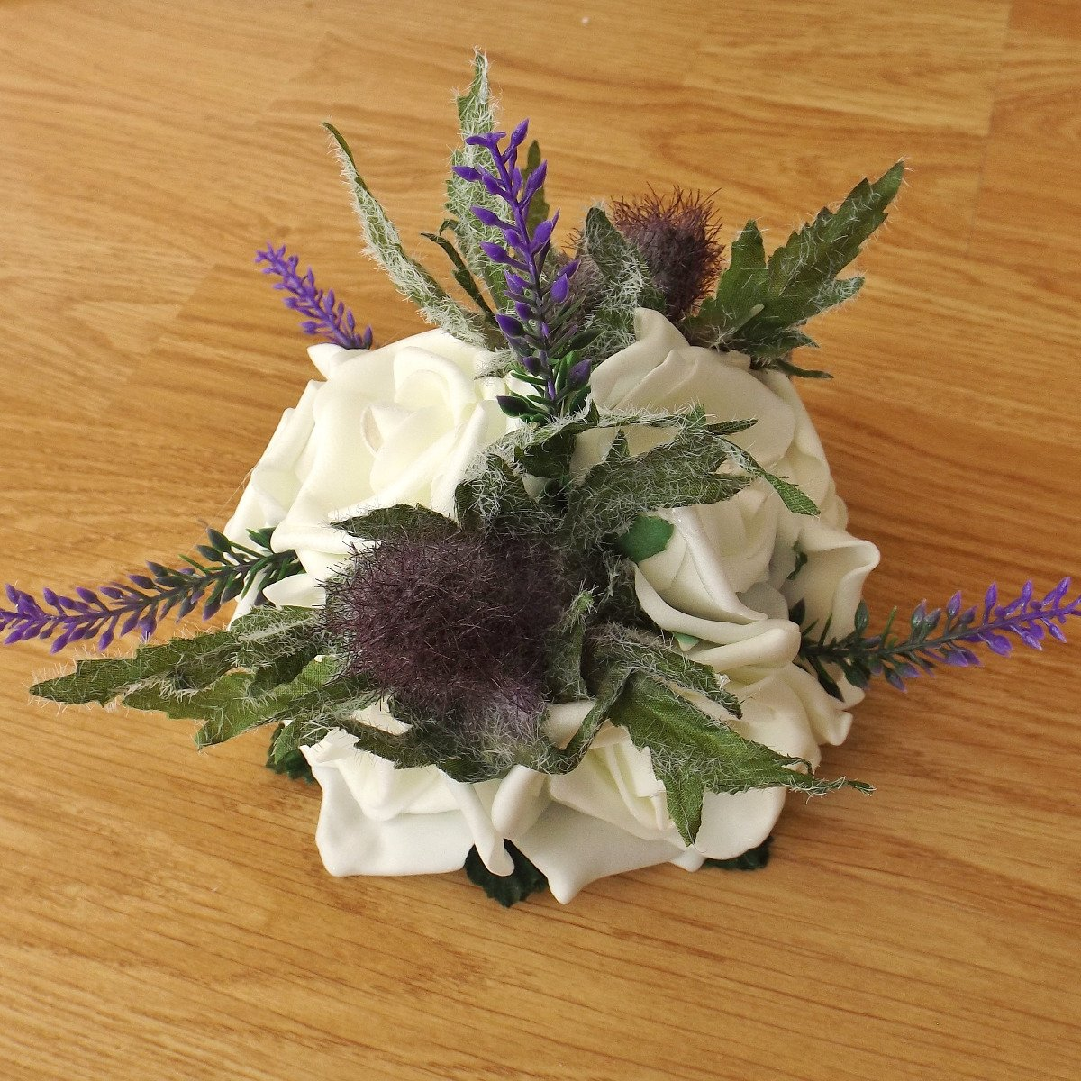 A thistle and heather artificial flower cake topper