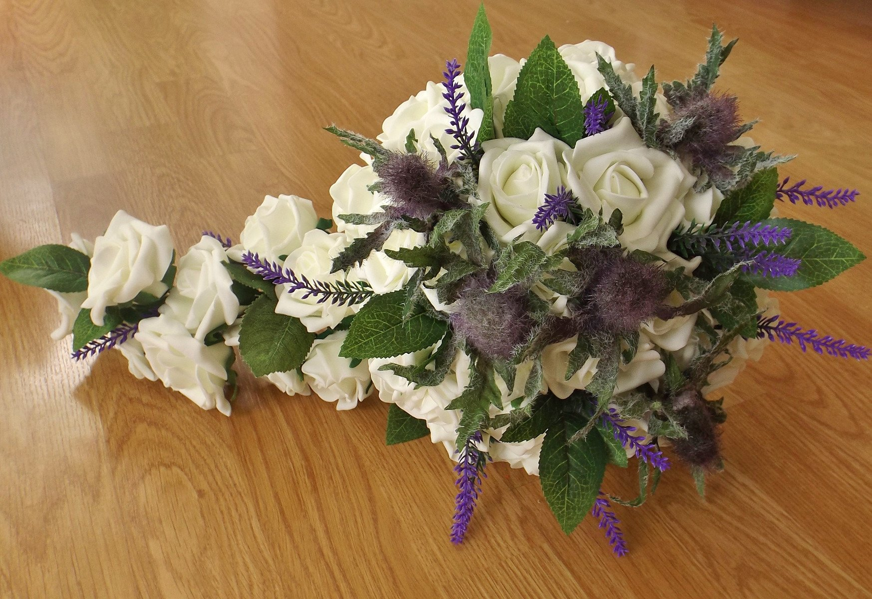 A thistle, heather and rose brides shower