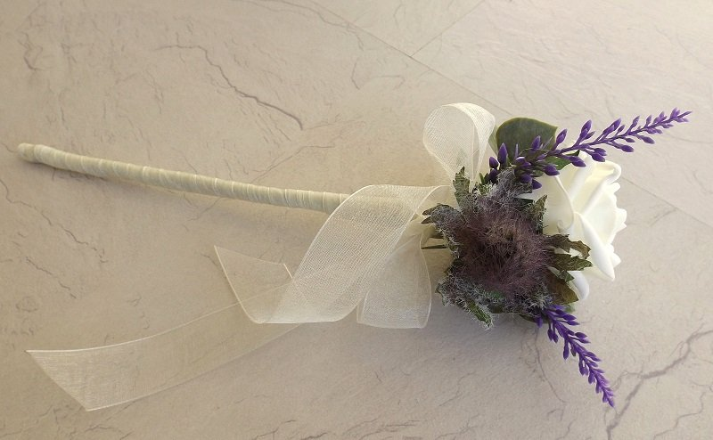 A thistle, rose and heather flowergirl wand