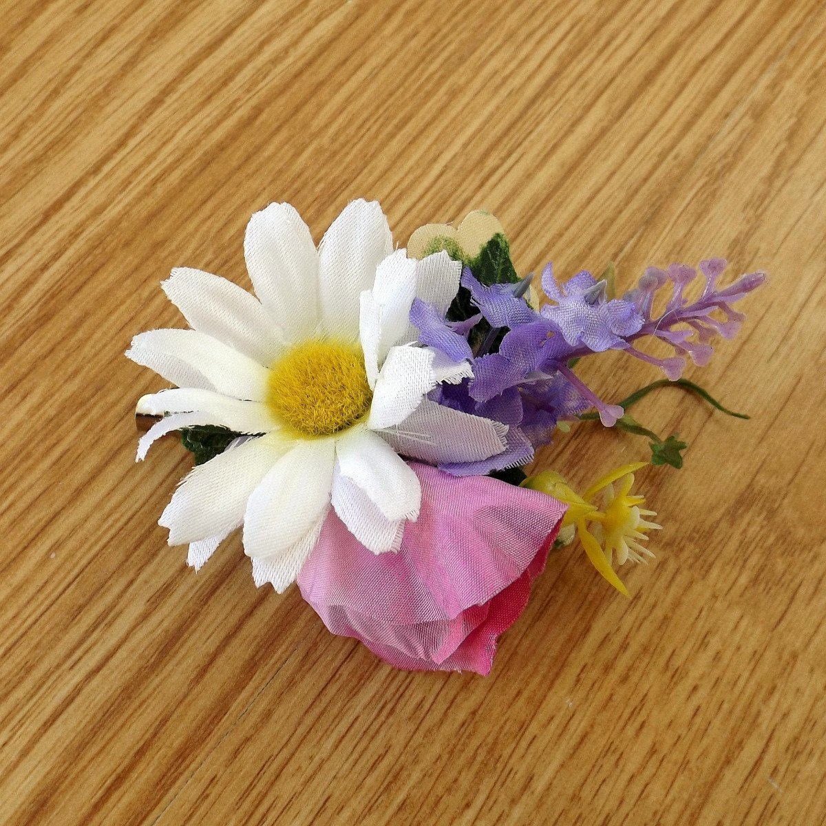 An artficial wedding flower hair clip